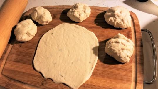Step 7: Roll each dough ball into a circle.